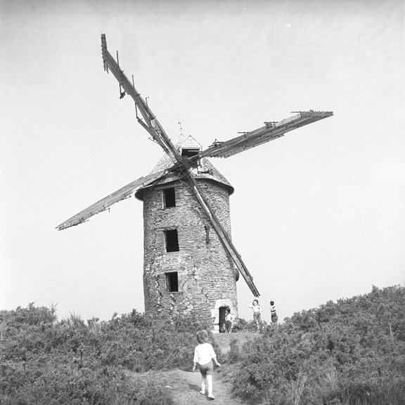Children dwarfed by a Spanish windmill. From Walt Girdner's Europe collection.