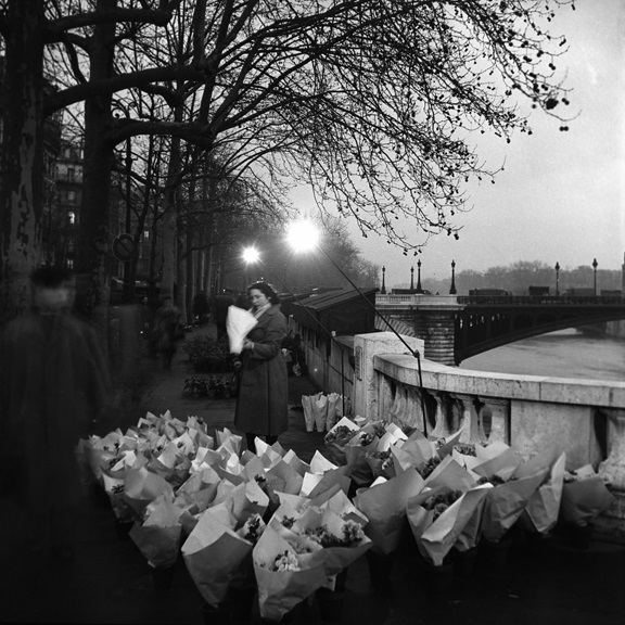 Selling flowers along the Seine. From Walt Girdner's Paris collection.