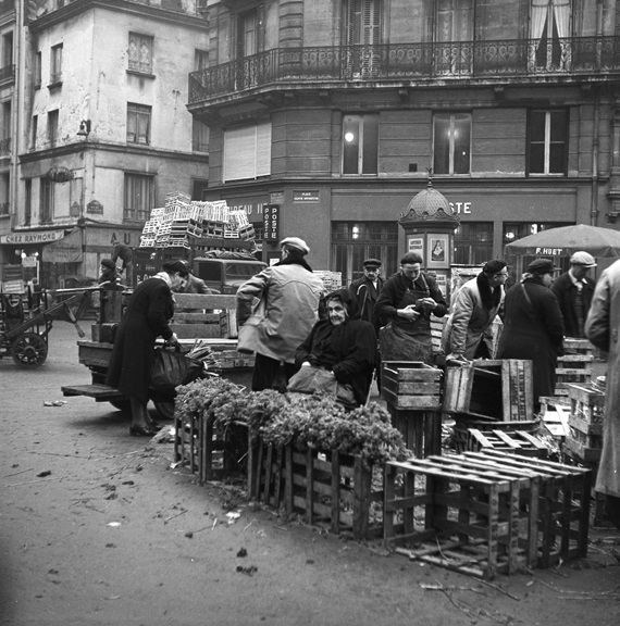 Selling herbs on market day. From Walt Girdner's Paris collection.