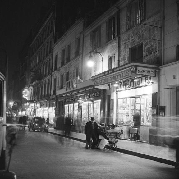Street peddler at night. From Walt Girdner's Europe collection.