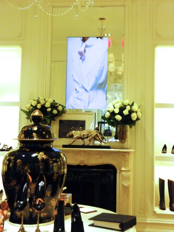 Vertical TV's in mirrors, Ralph Lauren runway in the NYC home flagship, as seen on www.CourtneyPrice.com