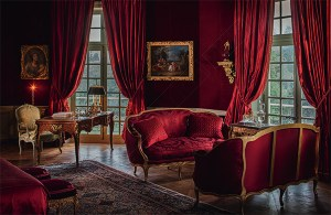 Red room, french decor, Chateau de Villette as seen on www.CourtneyPrice.com