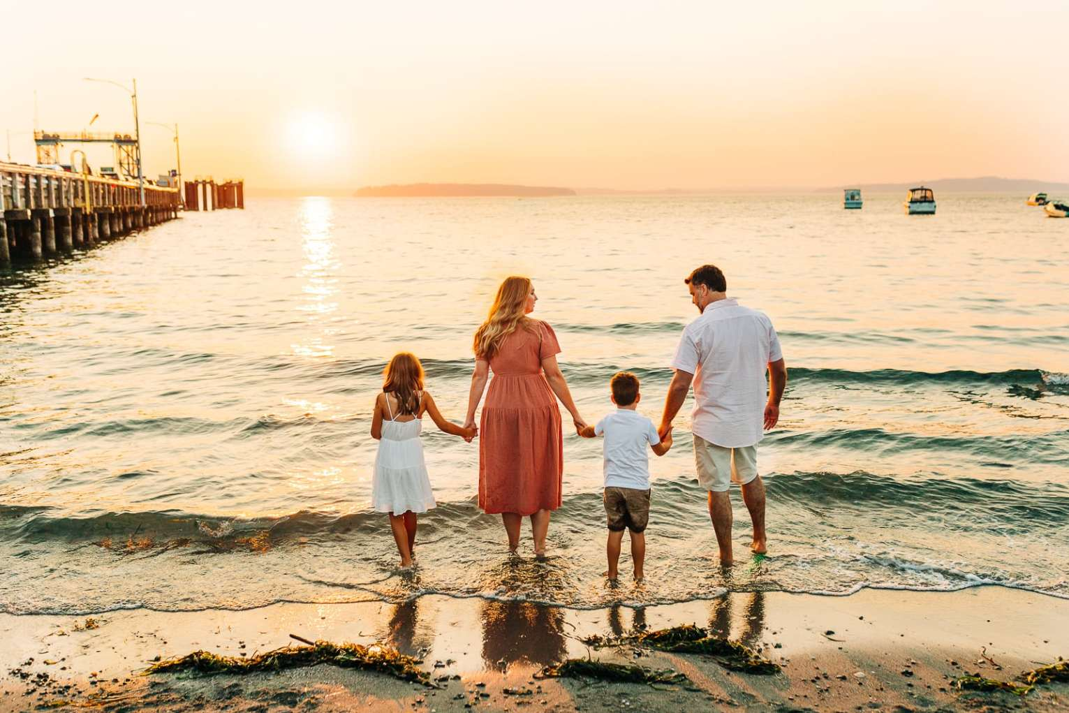 The fauntleroy ferry has a little beach next to it that makes for beautiful family photos.