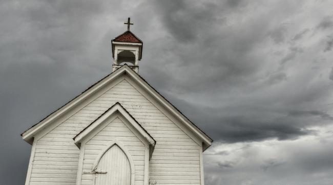 old country church near graveyard