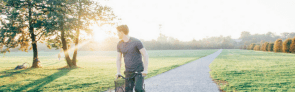 man biking on path alone