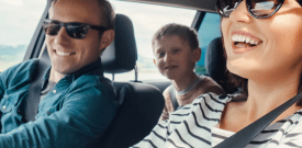 happy family driving in car
