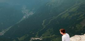 man overlooking cliff