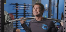 colossal man in gym with weights