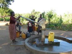 A woman uses a water point in her community constructed by the MCC-funded project in Northern Mozambique.
