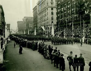 Photograph from our collections shows a parade of the 138th Infantry down Twelfth Street on May 9, 1919. This was the third of St. Louis's parades to welcome units home from World War I. Photograph by W.C. Persons, 1919. Missouri History Museum.