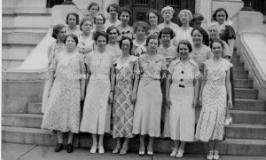 1930 Photograph of the Manchester City Library Staff. Group portrait of the Manchester City Library Staff showing twenty three women on the steps of the library. 1st row Addil Fitch; Miss Briggs; Winifred Woodward; Winifred Tattle?; Peggy Manchester. 2nd row— Miss Garrin; Marcella Cronin; Bea Fisher; Arlene Thorp; Jennie Lindquist; Lucille Chandonnet; Mary McClure. 3rd row— Emily Gile; Sue Fredrick. 4th row— Clay Constantine; Mary Russell; Miss Winchell, Librarian; and Miss Clement. MHA Photoprint Collection. Used with Permission.