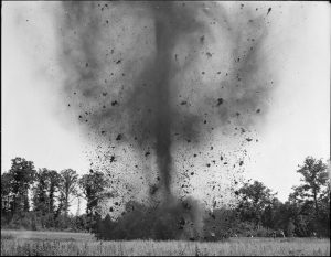 Photograph: Mine exploded by U.S. Soldiers in Hanover, MA, Courtesy of the Boston Public Library, Leslie Jones Collection.