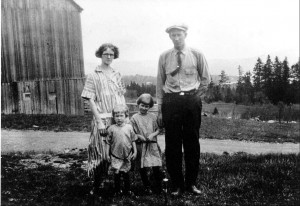 "Photograph of the Currier family of Pittsburg NH: Nettie (Witherell) Currier, Andrew ""Long Tom"" Currier, and their two daughters, Ruth and Edna."