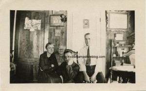 "Photograph of a family with a ghostly ""grandma. ""Unknown location, probably a double exposure taken in the 1920s. Purchased by the editor on an online auction website. Property of Janice Brown at Cow Hampshire Blog."