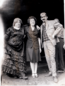 Mary Manning Webster stands in the center.  Red Hebert on the right, unknown person on left. 1946 Manchester City Centennial.