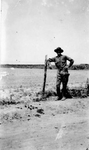 Portrait of William H. Jutras standing by the side of a road next to a wire fence on the Mexican Border possibly Bigford, Texas, 1949. From MHA Photoprint Collection, Manchester Historic Association Collection.