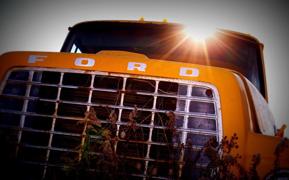 A rusty bumper of an orange car