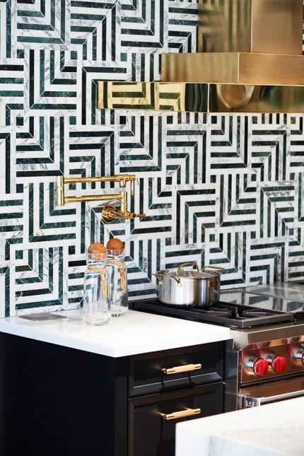 Pasadena luxury kitchen with eclectic tile backsplash and brass hood