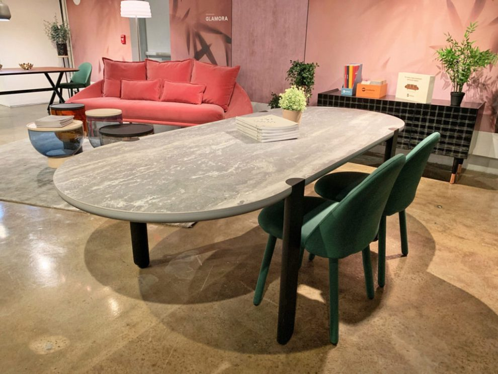 Spring 2019 Design Trends - rounded rectangle tables with forest green chairs, High Point Market