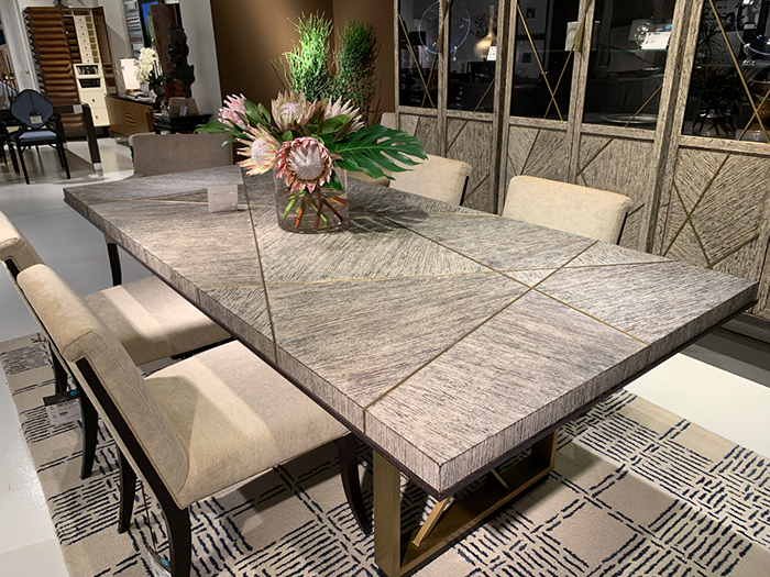 Wood grain parquetry with brass inlay dining table at Highpoint Market