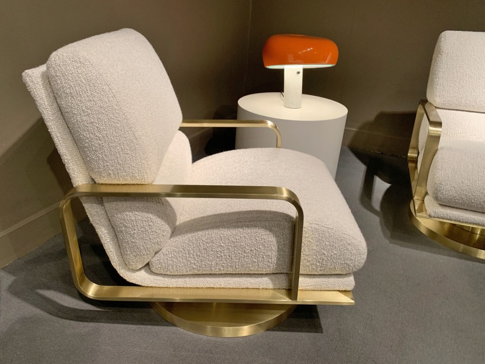 Milo Baughman off-white lounge chair with brass frame at Highpoint Market