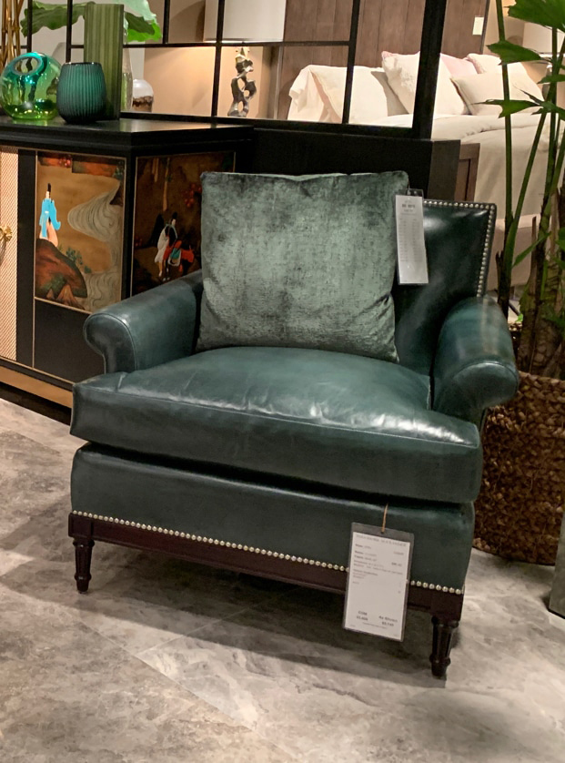 Forest green lounge chair at Highpoint Market