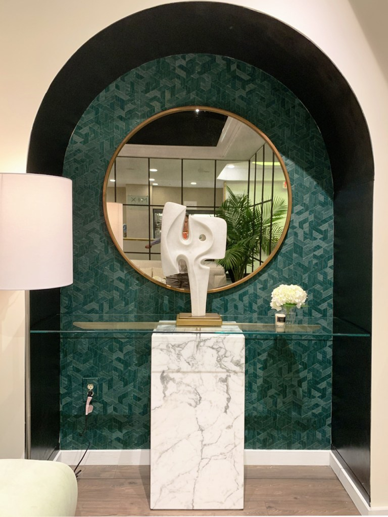 marble pedestal with forest green background at Highpoint Market