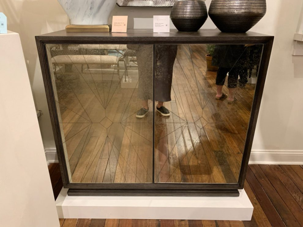 Mirror cabinet on elevated base Spring 2019 Design Trends - High Point Market