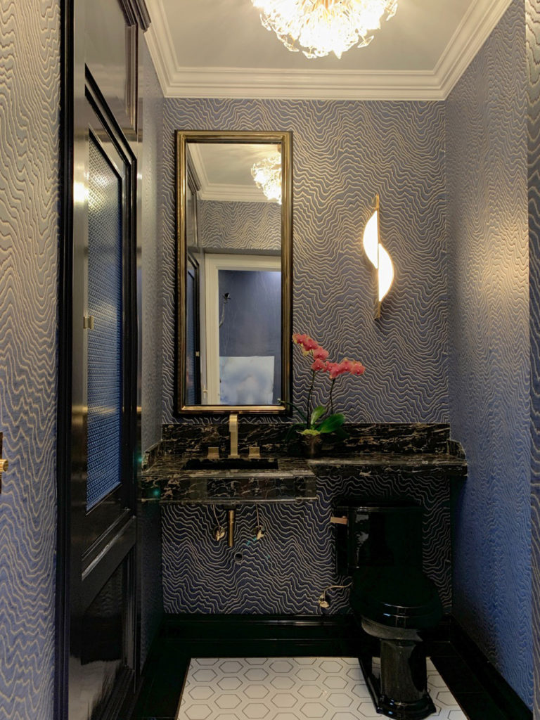 Powder room  in navy blue wallpaper and black marble for the 2019 Pasadena Showcase House located at the Boddy House on the Descanso Gardens property.  Designer: SH Interiors