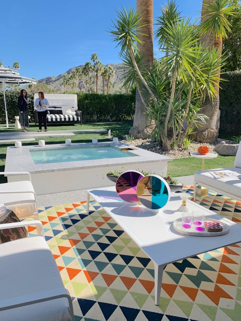 Colorful mid century outdoor living room and pool in Palm Springs