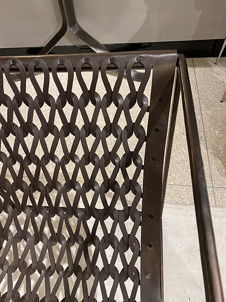 accent chair with large open weave - interior design trends 2021