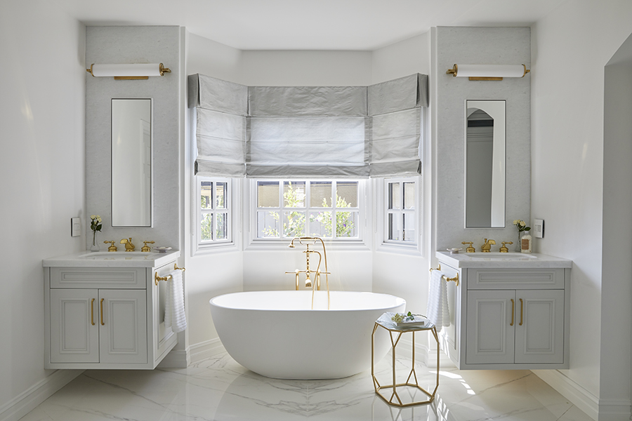 Luxury transitional white marble and brass bathroom