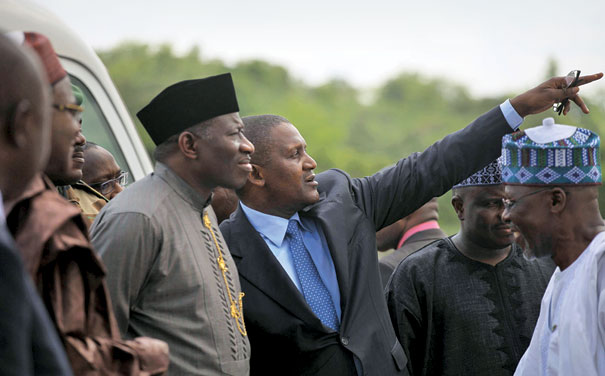 President Jonathan looks on as Dangote describes his plans to expand cement production in Obajana, Kogi State, Nigeria
