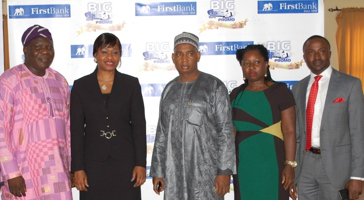L-R: Acting Director (Regulation & Monitoring), National Lottery Regulatory Commission, Prince Emmanuel O. Jeminiwa; Group Head, Product & Marketing Support First Bank of Nigeria Ltd, Mrs. Ezinne Obikile; Customer of FirstBank, Alhaji Abdullahi Mustapha; Consumer Banking FirstBank, Mrs. Adebimpe Ihekuna and KPMG Auditor; Mr. Martins Olajide at the maiden edition of the FirstBank 'Big Splash Promo Anniversary Edition which held in Lagos recently