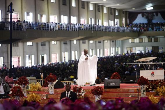 Bishop Oyedepo of Living Faith Church, also known as Winners' Chapel, conducts a service for worshippers in the church in Ota