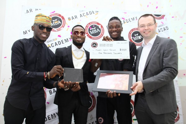 L-R Brand Ambassador, Smirnoff, DJ Spinall, Ciroc Ambassador, Dapo Oyebanjo (D'banj), Winner, Diageo Master Bar Academy (MBA), Michael Segun Toriola and GM Spirits, Diageo Brands Nigeria, Neil Comerford at the presentation of $1000 cash prize to the winner of MBA 303 competition.
