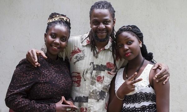 "Newzbeat's host Sharon Bwogi aka Lady Slyke (left), producer Daniel Kisekka aka ""Survivor"" (centre) and rapper 14-year-old Zoe Kabuye in Kampala. Photograph: Isaac Kasamani/AFP/Getty Images"