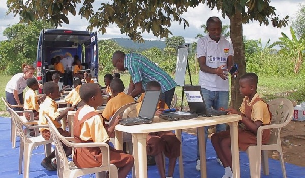 Photo showing students studying at a mobile library