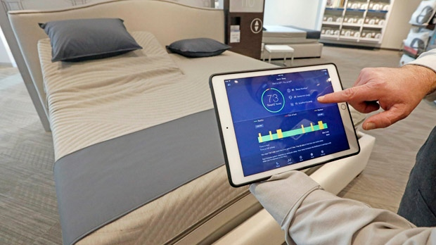 In This Friday July 7 2017 Photo Sleep Number Manager Lee Pulliam Demonstrates How The Company S Technology Tracks Your Sleeping Patterns