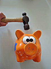 Piggy bank being smashed by Images Money