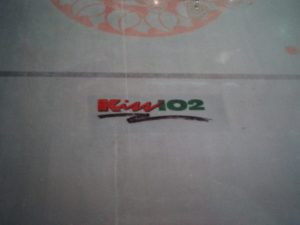 kiss fm station logo in the ice