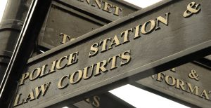 Sign post to Police and Law Courts