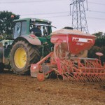 Seed drill sowing wheat