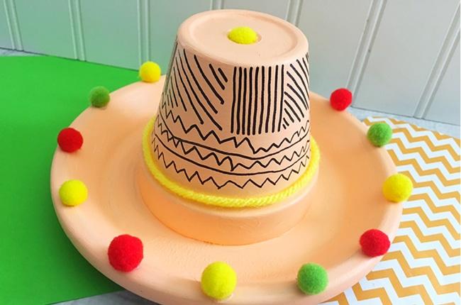 Have a fiesta and celebrate Mexican culture with this fun Cinco de Mayo Terra Cotta Pot Sombrero.