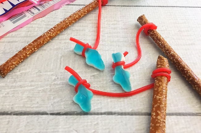 These Shark Week Fishing Pole Treats are a perfect snack for the kids to make and eat during Shark Week!