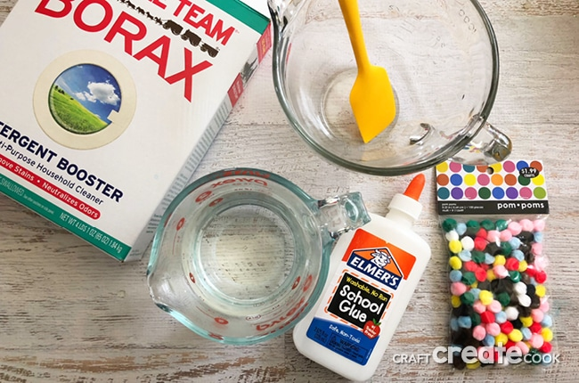 Our Sensory Slime is the perfect gooey slime with colorful pom pom balls for fun.