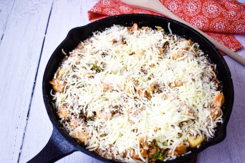 Shredded cheese on tortellini casserole