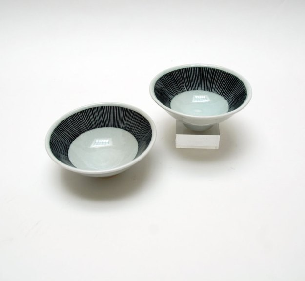 Pat Burns, Pair of Bowls, 2013. Soda/salt-fired porcelain, Madison Metro photograph