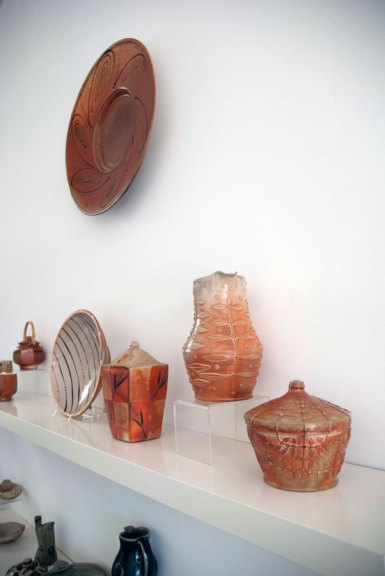 Andy Balmer & George Rector Andy Balmer, Platter, 2013. Soda/salt-fired stoneware (hanging on wall). George Rector, Covered Jars, Pitcher and Bowl, 2013. Stoneware, wood-fired, salt & soda glazed, Madison Metro photograph