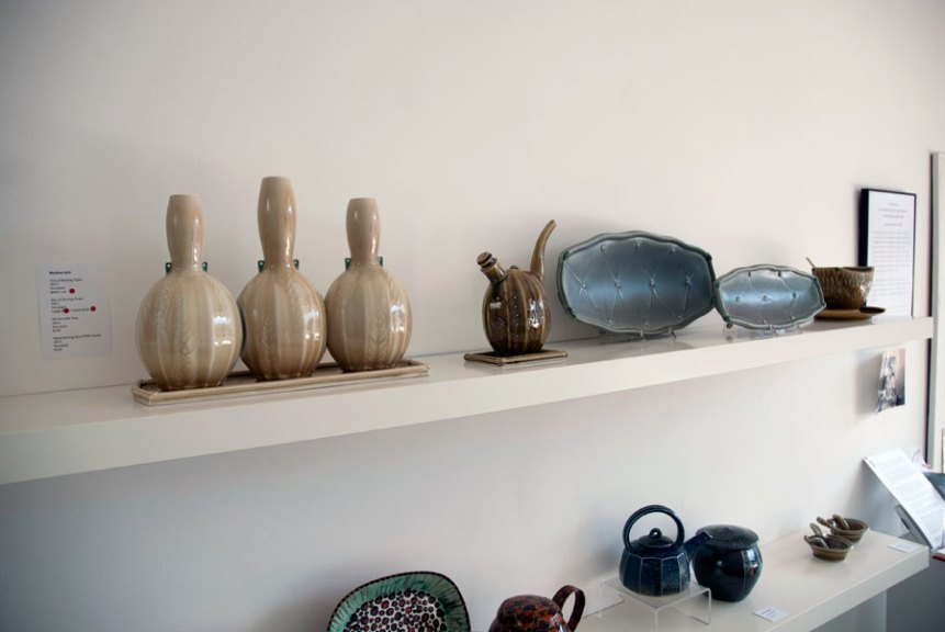Marlene Jack, Trio of Nesting vases, Oil pot with Tray, Pair of Serving Trays, 2013. Porcelain, Madison Metro photograph